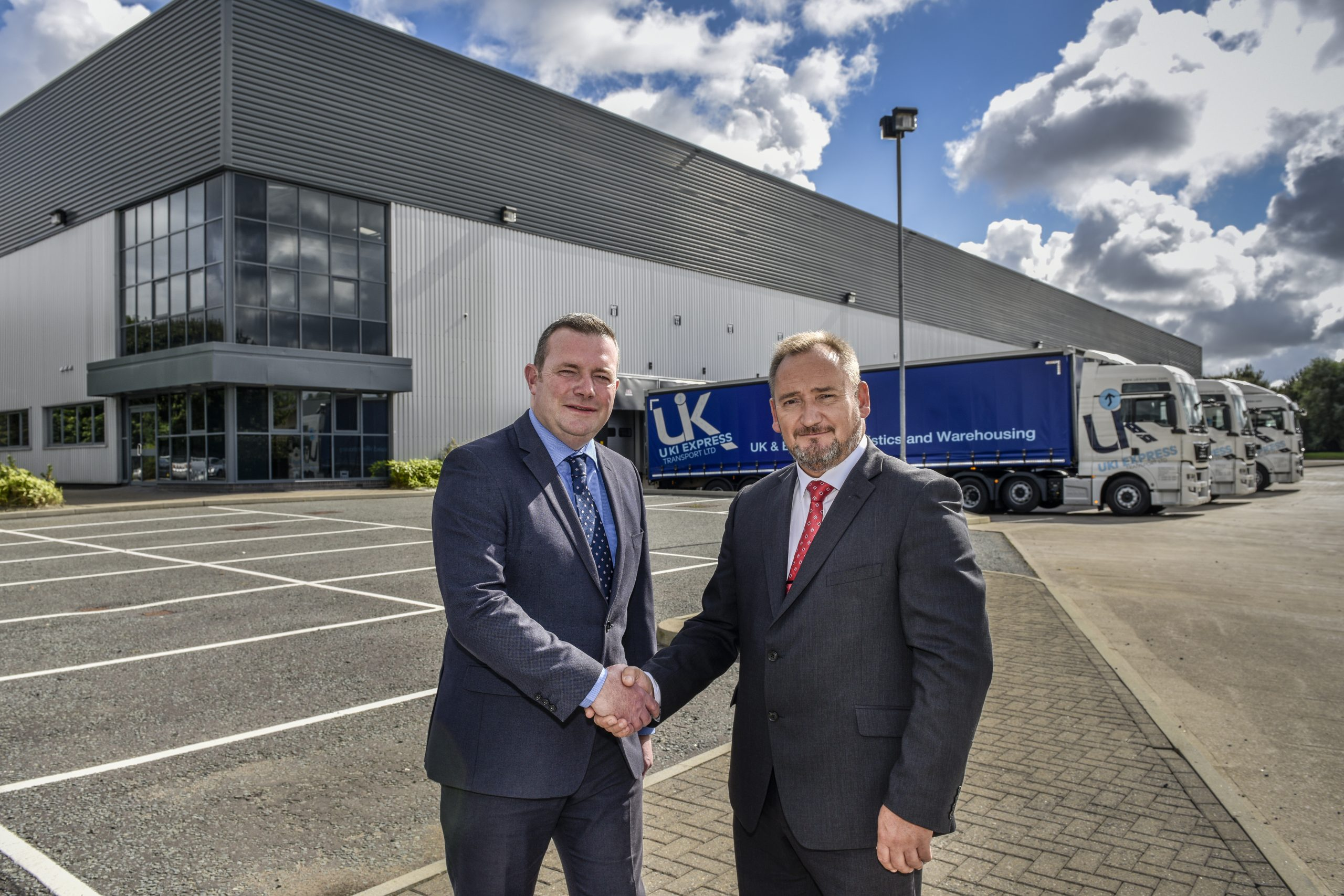 Peter Gummerson, Managing Director of UKI Express Transport Ltd and Dennis Dwyer, Orbit Developments' Divisional Director for Merseyside