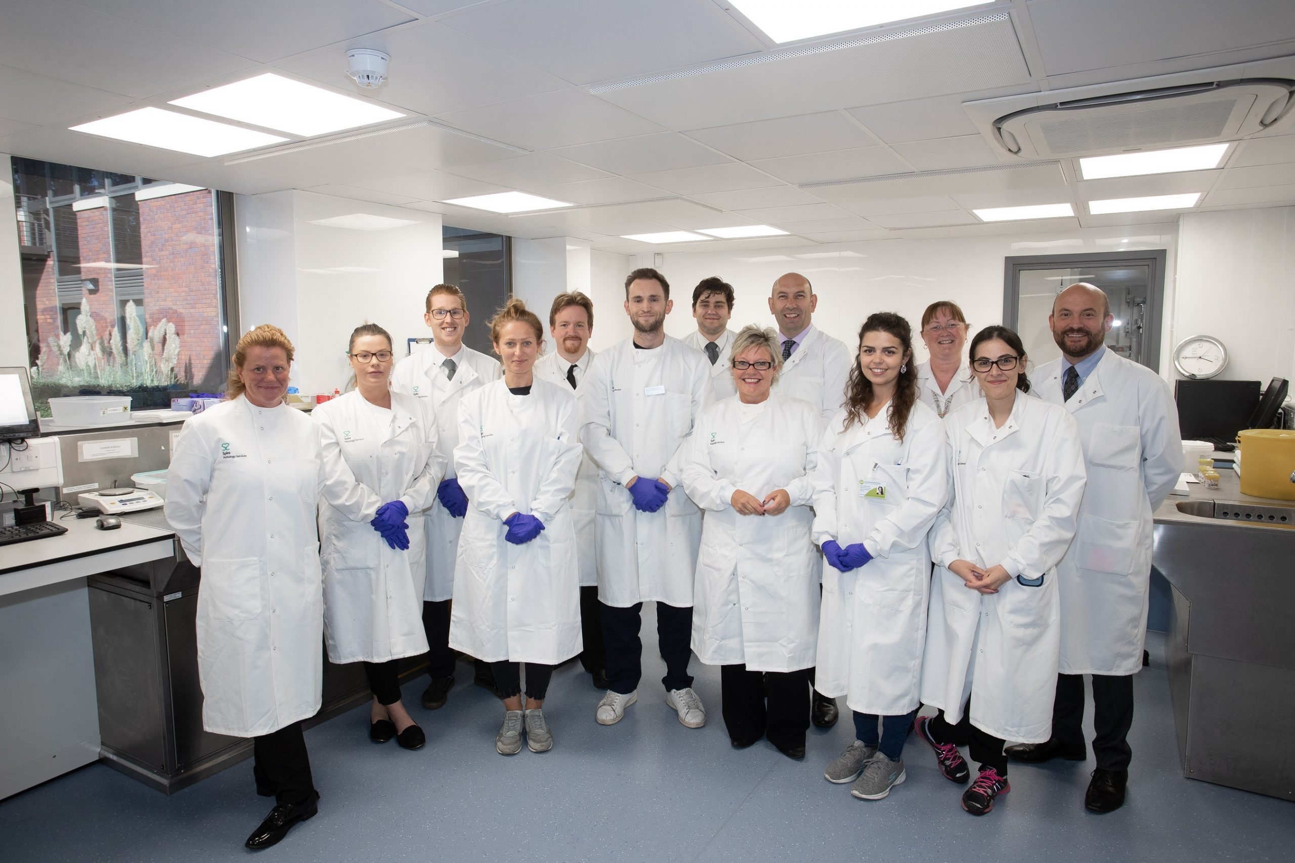 Far right: Dr Jean-Jacques (JJ) de Gorter, Group Medical Director at Spire Healthcare with the Histology Centre team in their new laboratory at Parkway